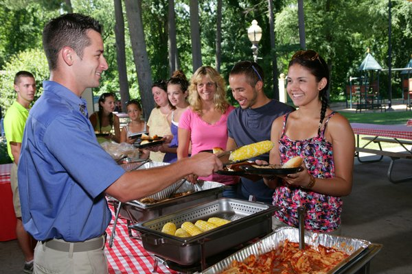 Group in a buffet line during a catered picnic