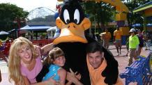 Daffy Duck poses with children