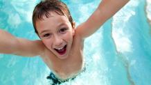 kid having fun at the water park