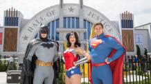 BATMAN, WONDER WOMAN and SUPERMAN standing majestically in front of JUSTICE LEAGUE: Battle for Metropolis