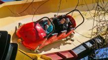 A family of four rides La Vibora bobsled coaster