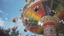 Children laughing and having fun on a swing Carousel