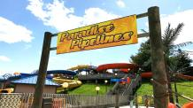 Paradise Pipelines entrance sign with slides in background