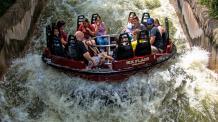 Guests riding Roaring Rapids