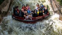 Guests riding Roaring Rapids