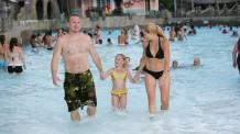 Family in water park pool at Six Flags New England Hurricane Harbor