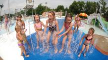 Kids playing in water jets