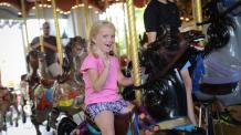 Girl riding the carousel