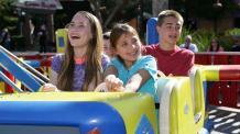 Kids riding Yosemite Sam's Hollywood Flight School