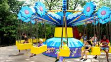 Children on Zinger Swings ride at Six Flags New England