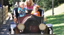 Family riding in Antique Car