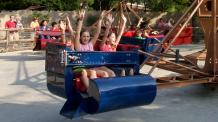 Kids with hands up on Sidewinder