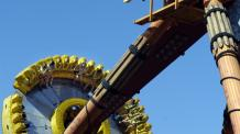 Tomahawk swings riders high above the Midway at Six Flags New England