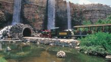 Guests Riding train passing by three waterfalls entering tunnel