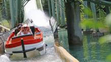 Two ladies coming down water flume in orange Yankee Clipper boat