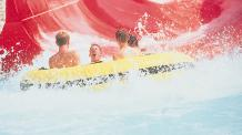 Guests ride a raft on the Big Kahuna family raft ride