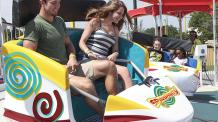 Guests enjoying rotating and spinning car of Spinsanity