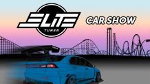 cartoon car set in front of coaster skyline
