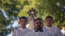 Religious garments on men leading a religious symbol