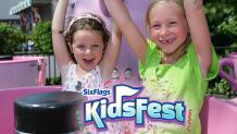 Two children spinning on Krazy Kups at Six Flags New England