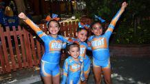 cheerleaders standing and posing