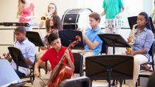 group of kids with instruments