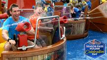 Guests spraying water from on a ride