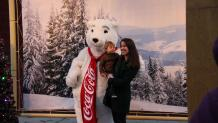 Mother and son with coca-cola bear