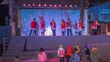 Children enjoying a holiday performance