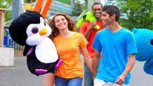 girl and guy walking with stuffed animal