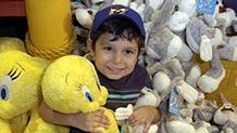 child with looney tunes stuffed animals