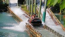 Two girls splashing down Logger's Run