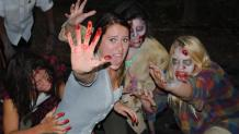 Girl getting attacked by zombies