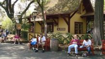Guests sit down outside the Texas Depot train station