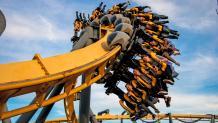 Riders flip through a corkscrew on BATMAN The Ride