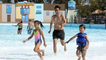 family splashing in the pool