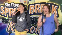 Two friends sing karaoke at Six Flags