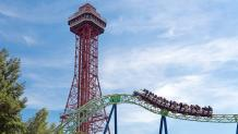 Guests riding Shock Wave by the Oil Derrick