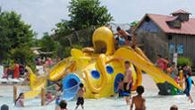 Kids on octopus water jungle gym