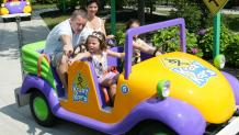 Family riding Krazy Kars at The Great Escape
