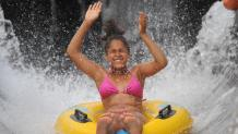 Girl tubing through water attraction