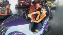 Families enjoying bumper cars