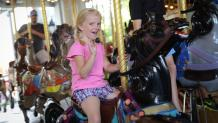Girl riding the carousel