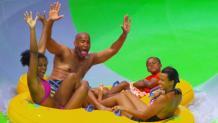 Family rafting down slide