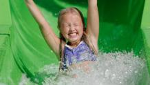 Tiny guest on water slide