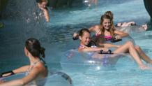 Kids floating in inner tubes at Adventure River at Six Flags New England Hurricane Harbor