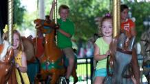 Children on the Silver Star Carousel