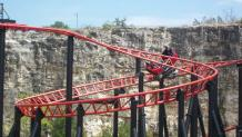 Guests enjoying a ride on the spinning Pandemonium coaster