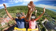 Riders in virtual reality headsets on SUPERMAN™ Ride of Steel
