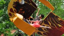 Guests riding Screamin Eagles at Six Flags Great Escape